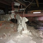 Old deteriorated asbestos at drain piping